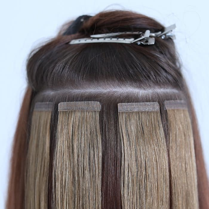 Tape in hair extensions: A solution for voluminous hair 2